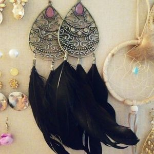 Large black feather earrings.